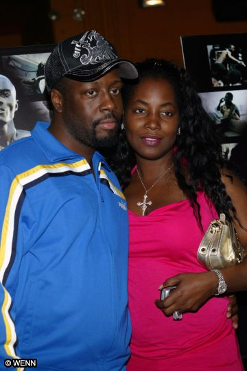 TALK ABOUT BLACK BEAUTY MEETS BLACK BEAUTY! THE PERFECT BLACK COUPLE! CLAUDINETTE ,A BLACK SKINNED BEAUTY GOT HER A FINE BLACK SKINNED HUSBAND WYCLEF JEAN WHO LOVES HER BEAUTIFUL BLACK SKIN! AND YOU WILL TOO!