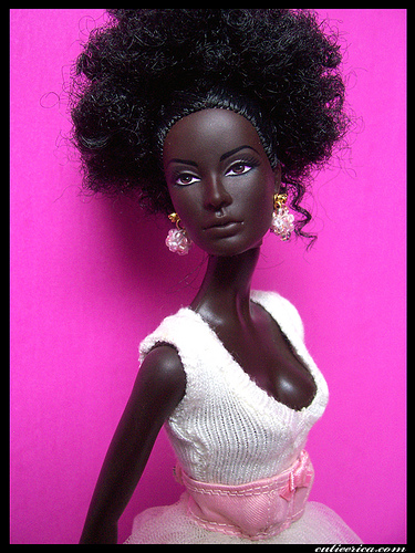 AT LAST A TRULY BLACK SKINNED BEAUTY DOLL WITH SORT OF WOOLLY HAIR!