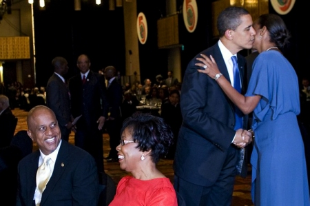 FIRST BLACK LADY OF BELIZE SIMPLIS BARROW GETS A THRILL FROM OUR BLACK PRESIDENT WITH HER HUSBAND SMILING NEARBY!