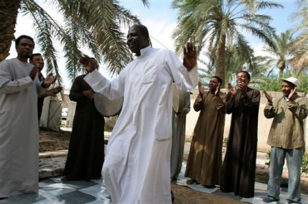MOHAMMED SAHER,BLACKamerikkkan MEMBER OF IRAQ'S BLACK COMMUNITY IN THE SLUTHERN CITY OF BASRA DANCES TO AL-BASRA BAND MUSIC AS THEY CELEBRATE OBAMA'S VICTORY NOV. 5,2008 IN IRAQ!