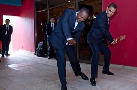WORLD-FAMOUS CRICKET LEGEND BRIAN LARA SHOWS PRESIDENT OBAMA HOW TO PROPERLY SWING A BAT ON APRIL 19,2009 IN TRINIDAD AND TOBAGO