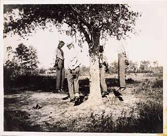 The lynching of four unidentified African Americans. Circa 1900 ...