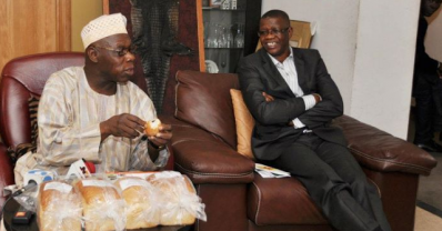 OBASANJO EATING CASSAVA BREAD!