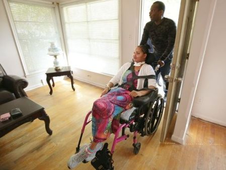 Dreia Davis and her father Curtis White, enter their new home for the first time on Wednesday, September 23, 2015, in Detroit. The handicap-friendly furnished house and a van were donated to the family by Detroit Rescue Mission. (Photo: Salwan Georges / freep.com)